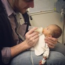 Daddy feeding Nashin the NICU