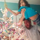 Putting the tree topper on with Daddy's help (2018)